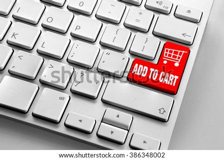 Computer keyboard with red add to cart button