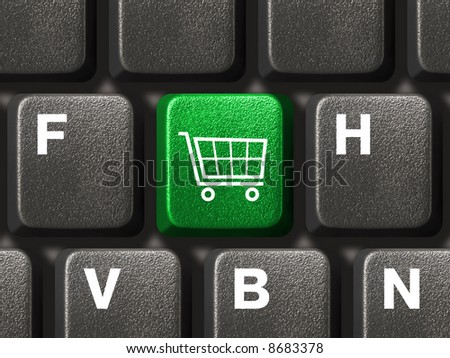 Computer keyboard with shopping key - stock photo