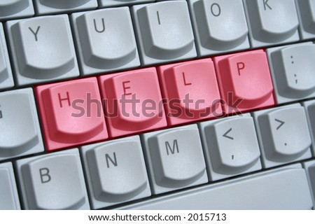 Computer keyboard with the word HELP spelt on the keys in red