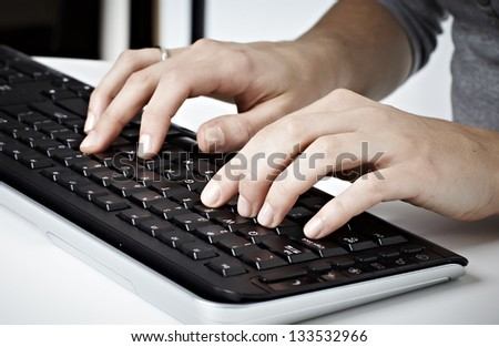 Computer keyboard. Woman hands typing message. Office life. - stock photo