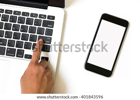 Computer laptop and smart phone on white background - stock photo