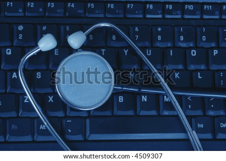 Computer laptop and stethoscope with a blue tent - stock photo