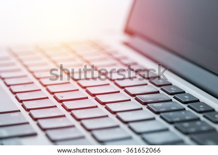 Computer laptop close up. Vintage filter - stock photo