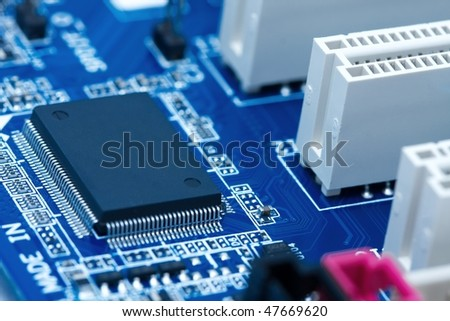 Computer mainboard with many electronic components - stock photo