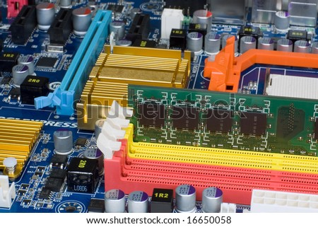 Computer memory module in mainboard slot.