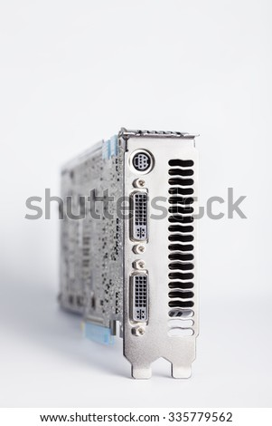 Computer modern graphic card with shadow. Focus on connectors - stock photo