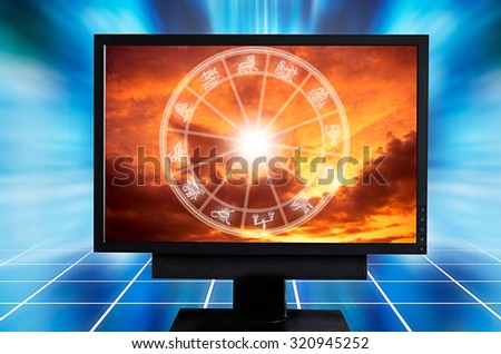 computer monitor with astrological signs and chart inside it - stock photo