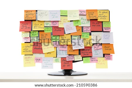 Computer monitor with post-it notes on it  - stock photo