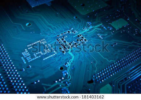 Computer motherboard artistic abstract background in blue color - stock photo