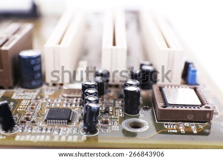 Computer motherboard on white background, macro view - stock photo