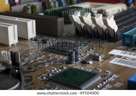 Computer motherboard, small DOF view, PCI, memory and CPU sockets - stock photo