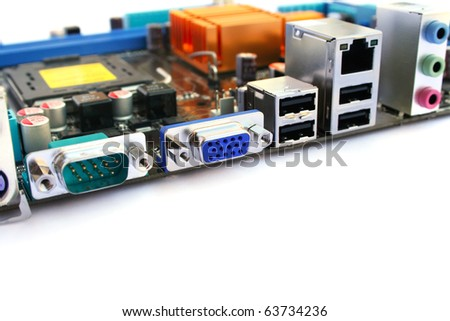 Computer motherboard with many electronic components. - stock photo