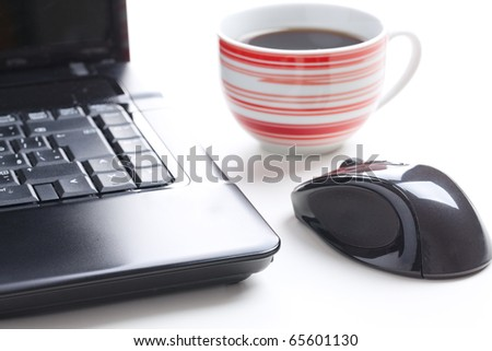 computer mouse and coffee cup - stock photo