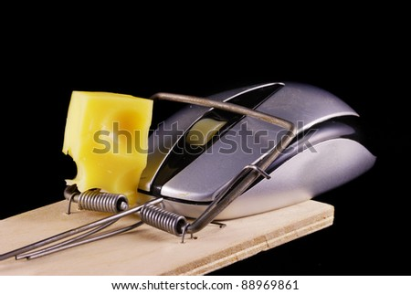Computer mouse and mousetrap isolated on black background - stock photo