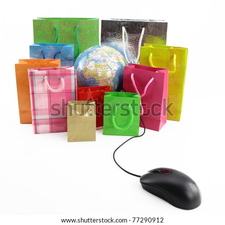 Computer mouse connected to a group of shopping bags with a globe inside - stock photo