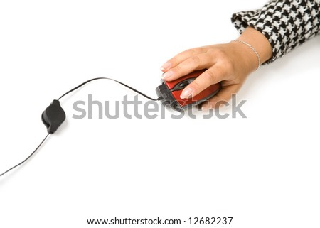Computer mouse in female hand isolated on white - stock photo