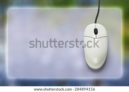 Computer mouse on blank background  in closeup