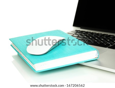 Computer mouse on book and notebook isolated on white - stock photo