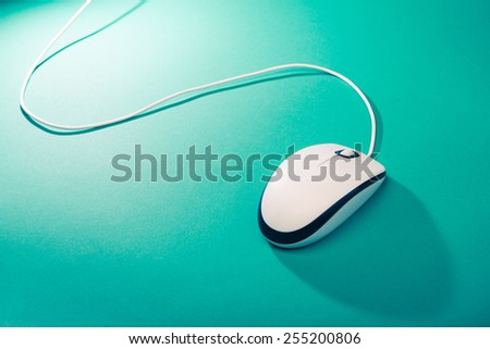 computer mouse on emerald background - stock photo