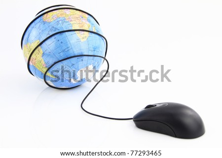 Computer mouse wraps the world globe - stock photo