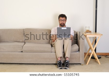 computer nerd finds something exciting while surfing the net - stock photo