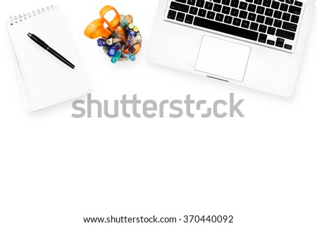 Computer notebook and stationary isolated on white background