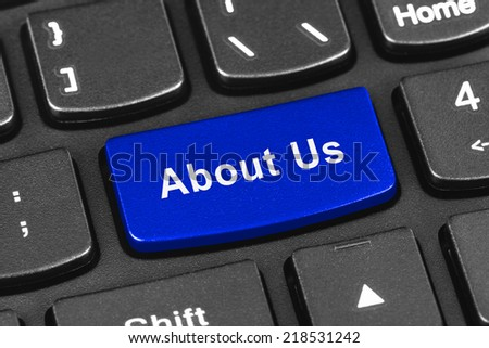 Computer notebook keyboard with About Us key - technology background - stock photo
