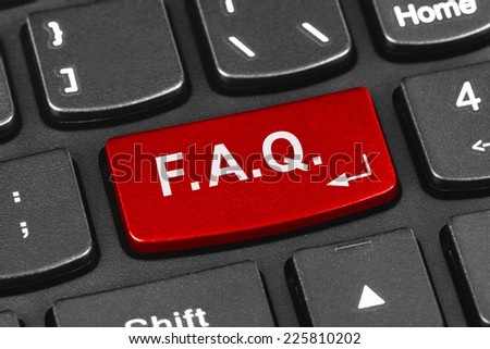 Computer notebook keyboard with FAQ key - technology background - stock photo