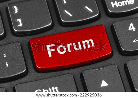 Computer notebook keyboard with Forum key - technology background - stock photo