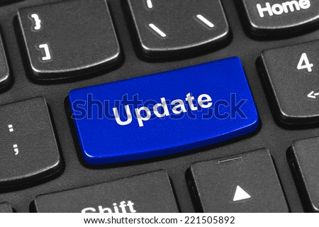 Computer notebook keyboard with Update key - technology background - stock photo