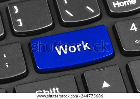 Computer notebook keyboard with Work key - technology background - stock photo