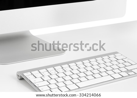Computer on white table, close-up, monitor, keyboard