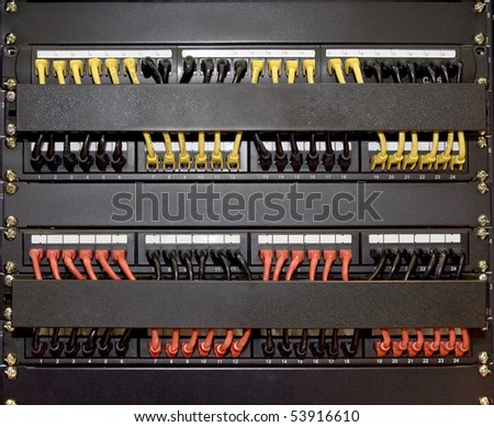 computer patch cords panel  cabling rack mount cabinet colored category cabling - stock photo
