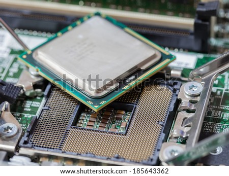Computer Processing Unit on Mainboard Circuit. - stock photo
