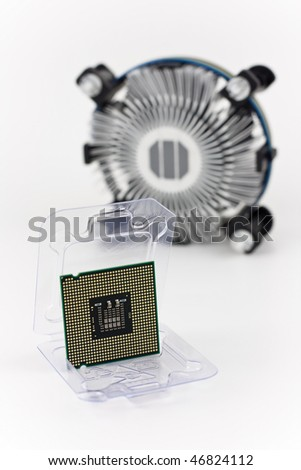 computer processor in packing and CPU fan out of focus - stock photo