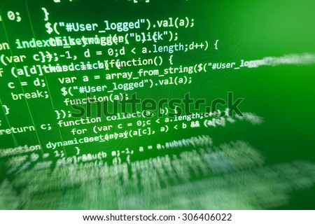 Computer program code. Web developer computer screen, closeup of monitor background.  Shallow depth of field, selective focus effect.  - stock photo