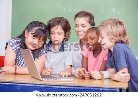 Computer science primary multi ethnic classroom. - stock photo