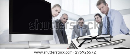 Computer screen against business colleagues discussing about work - stock photo