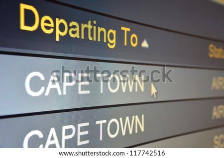 Computer screen closeup of Cape Town flight status - stock photo