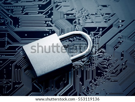 Computer security concept. Padlock on computer circuit board