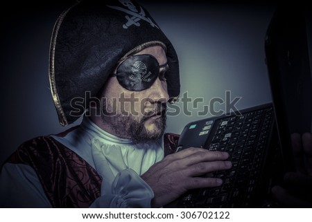 computer security, hacker pirate dress with hat and skull - stock photo