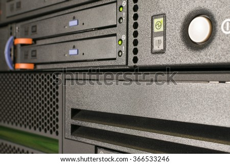 Computer Server and  CD or DVD and tape drive in datacenter - stock photo