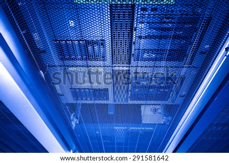 computer server in rack with blue light close up - stock photo