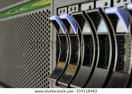 Computer Server mainframe and raid storage in datacenter - stock photo