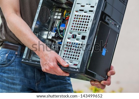 Computer specialist with equipment - stock photo