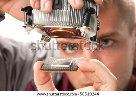 Computer support engineer installing processor - stock photo
