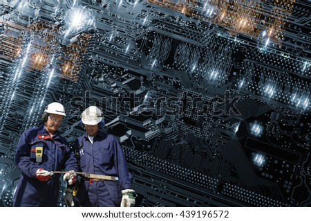 computer technicians with a giant circuit-board, microchips, transmitters and electrodes - stock photo