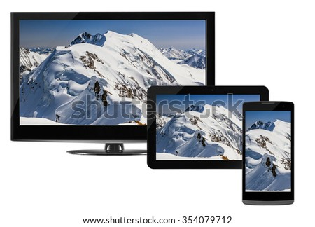 Computer technology, mobility and communication business concept: laptop or mini tablet computer, touchscreen smartphone and desktop monitor display screen TV isolated on white - stock photo
