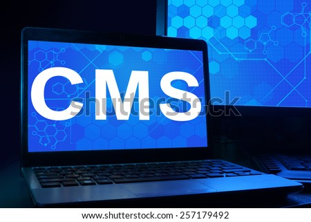 Computer with word  cms. Internet technology concept.