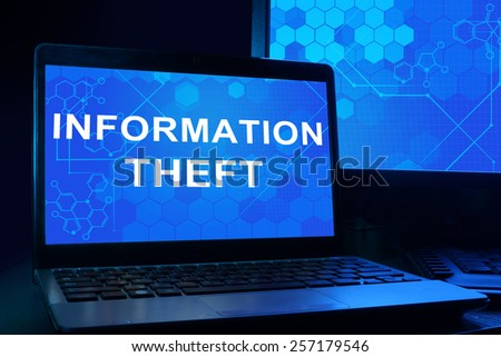 Computer with words Information Theft. Internet technology concept. - stock photo